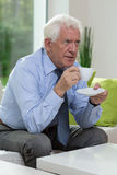 Man drinking coffee at home Stock Images