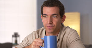 Man drinking coffee while looking away Stock Photography