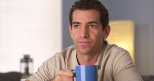 Man drinking coffee while looking away Royalty Free Stock Images