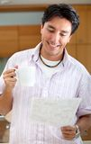 Man drinking coffee and reading Royalty Free Stock Photo