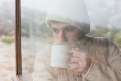 Man drinking coffee seen through cabin window Royalty Free Stock Photo