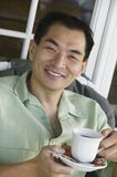 Man drinking coffee smiling (portrait) Royalty Free Stock Images