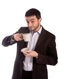 Man drinking coffee in a suit royalty free stock photography