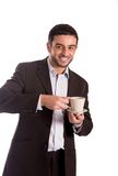 Man drinking coffee in a suit Stock Images