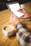 Man drinking coffee and touching tablet computer Royalty Free Stock Photo