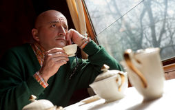 Man drinking coffee in train Royalty Free Stock Images