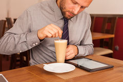Man drinking coffee and using tablet and mobile Royalty Free Stock Photo