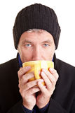 Man drinking coffee in winter Stock Image