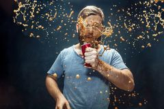 Man drinking a cola and enjoying the spray. royalty free stock photography