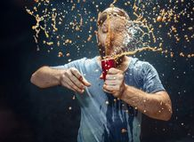 Man drinking a cola and enjoying the spray. royalty free stock image