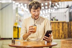 Man drinking cold bubble tea in cafe royalty free stock photos