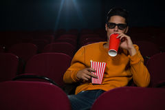 Man drinking cold drinks while watching movie Royalty Free Stock Photos
