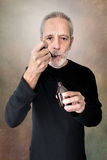 Man Drinking Cough Syrup Stock Photography