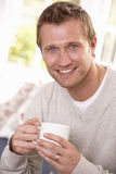 Man drinking from cup Stock Photography