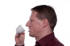 Man is drinking a cup of coffee Royalty Free Stock Image