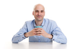 Man drinking a cup of coffee or tea Royalty Free Stock Images