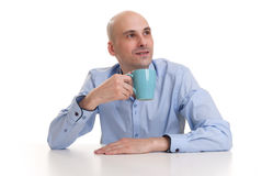 Man drinking a cup of coffee or tea Stock Photo