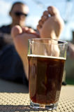 Man drinking dark beer in garden Royalty Free Stock Photo