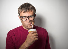 Man drinking from a disposable paper cup Stock Photos