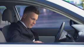 Man drinking on driver seat and getting out of car, dangerous habit, addiction. Stock footage stock video