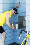 Man at a drinking fountain Stock Photos