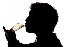 Man drinking glass of champagne Stock Photo