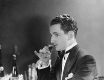 Man drinking glass of liqueur Royalty Free Stock Photography