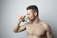 Man drinking glass of pure water Stock Photo