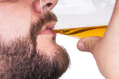 Man drinking a glass of whisky Royalty Free Stock Images
