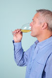 Man drinking a glass of white wine Stock Photos