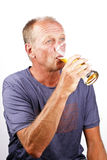 Man drinking his beer Stock Images