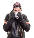 Man drinking hot beverage to stay warm Stock Photos