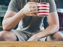 Man drinking hot coffee tea or cocoa. royalty free stock photos