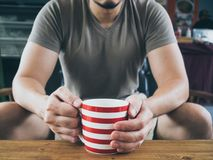 Man drinking hot coffee tea or cocoa. royalty free stock images