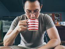 Man drinking hot coffee tea or cocoa. stock photography