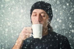 Man drinking hot tea Stock Photography