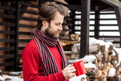 Man drinking hot tea outdoor - winter countryside landscape Royalty Free Stock Photo