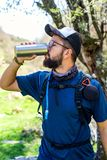 Man drinking from a insulated bottle royalty free stock image
