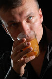 Man drinking juice Stock Images