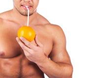 Man is drinking juice Stock Photos