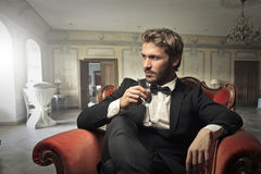 Man drinking in the living room Royalty Free Stock Photography