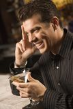 Man drinking martini. Stock Images