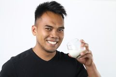 Man drinking milk Royalty Free Stock Images