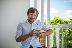 Man drinking a mojito on the terrace. Royalty Free Stock Photos