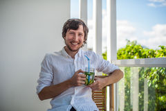 Man drinking a mojito on the terrace. Stock Photos