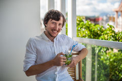 Man drinking a mojito on the terrace. Stock Images