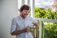 Man drinking a mojito on the terrace. Royalty Free Stock Images