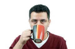 Man drinking from a mug Stock Images