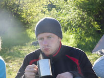 Man drinking from a mug. Stock Images