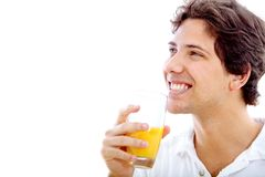 Man drinking orange juice Royalty Free Stock Image